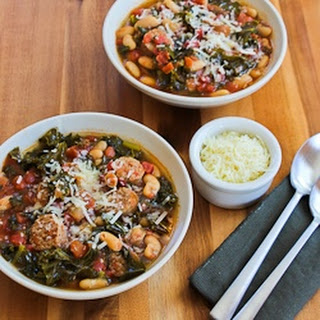 Slow Cooker Cannellini Bean Stew with Tomatoes, Italian Sausage, and Kale.