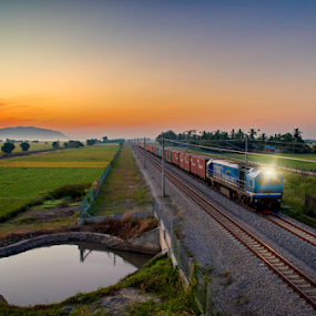 Technology VS Nature by Mohammad Khairizal Afendy - Transportation Trains ( old, technology, travel, transportation, yellow, transit, city, subway, farmer, village, nature, movement, train, motion, move, carriage, engine, electric, journey, malaysia, railway track, smoke, country, tourist, railway, tunnel, wheel, railroad, vehicle, way, road, express, cargo, business, farm, modern, train station, transport, rail, pond, water, rice, speed, vintage, paddy, steel, passenger, field, locomotive, peace, sunrise, public, mist, renewal, green, trees, forests, natural, scenic, relaxing, meditation, the mood factory, mood, emotions, jade, revive, inspirational, earthly,  )