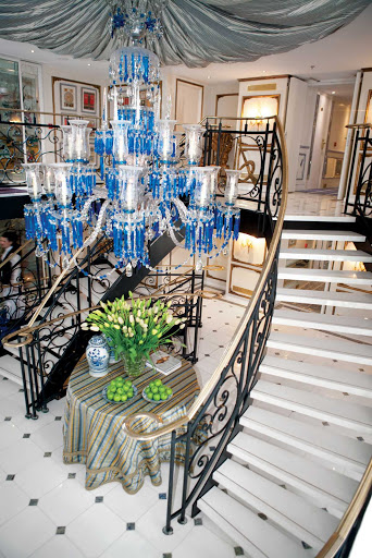 S.S. Antoinette's elegant lobby is lit up by a stunning crystal Baccarat chandelier.