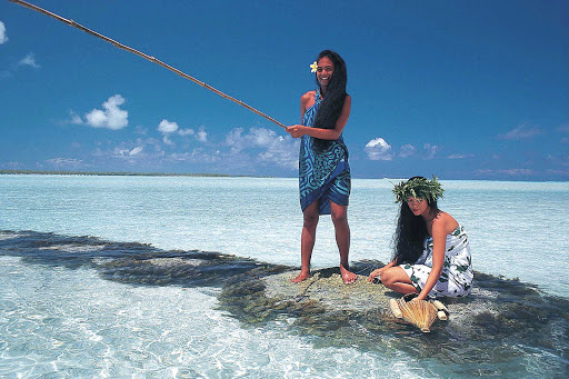 Women fish in Fakarava in the Tuamotu atolls of French Polynesia.