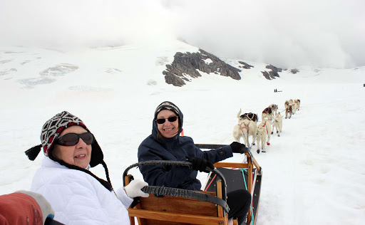 sled-dogs - Mush! Here's me and mom actually taking a dog sled ride.. on a glacier!
