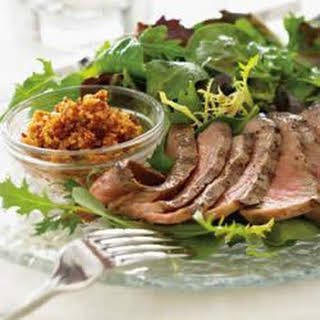 Mixed Greens with Grilled Steak and Walnut Romesco.
