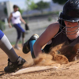 I love these sliding pictures, look at the texture in that dirt coming up! Great slide and she was safe :) by Jake Putnam - Sports & Fitness Baseball
