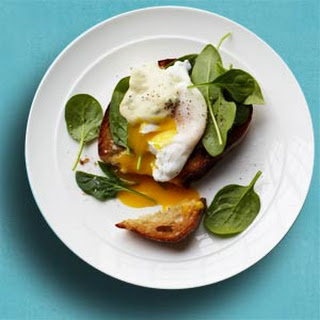 Crostini with Spinach, Poached Egg, and Creamy Mustard Sauce.