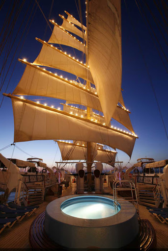 Royal-Clipper-sails-at-night - Relax in Royal Clipper's deluxe whirlpool at night when the ship is lit up.
