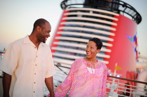 Disney-Dream-Guests-on-Deck - Disney Dream is suited for couples, singles and families, with shore excursions, on-board spa treatments and nighttime entertainment.