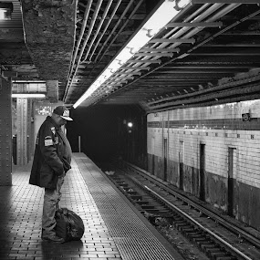 Is it coming? by Eladio Gomes - Black & White Street & Candid ( metro, black & white, street, nyc, new york, lonely, alone, man,  )