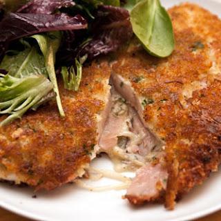 Stuffed Chicken Cutlet With Ham, Cheese, and Sauerkraut.