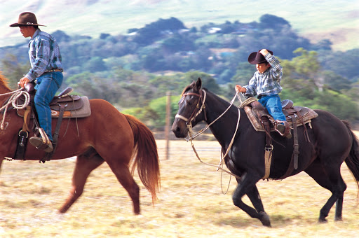 A young horseback rider in Waimea, Hawaii. Mexican cowboys, called paniolo, first came to Hawaii 170 years ago.