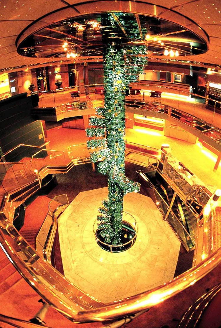 At the center of the atrium of  Holland America Line's Veendam is a luminous, spangled three-story spiral of cut crystal that climbs from floor to ceiling.