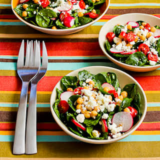 Mediterranean Spinach Salad Recipe with Garbanzos, Tomatoes, Radishes, and Sumac-Lemon Vinaigrette.