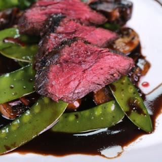 Marinated Steak with Mushrooms and Snow Peas.