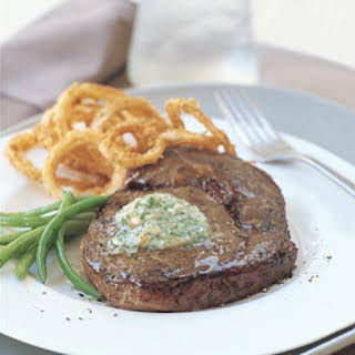 Rib-Eye Steaks with Gorgonzola Butter and Crispy Sweet Onion Rings.