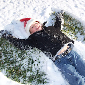 My Snow Angel by Shannon Maltbie-Davis - Public Holidays Christmas ( winter, snow angel, snow, santa hat, boy, generic winter season picture with happy people, happy snowy experience,  )