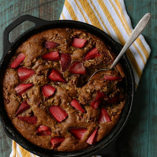 Brown Butter Banana Skillet Cake with Strawberries and Pecans.