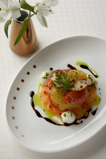 CEL_tuscan_tomato_salad - Tomato salad prepared at the Tuscan Grille on your Celebrity Cruises voyage.
