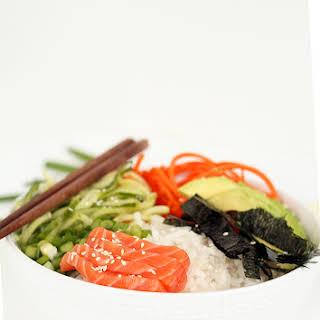 Spiralized Sushi Bowl with Salmon Sashimi and Ginger Miso Dressing.