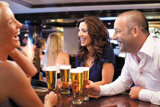 Norwegian-Epic-O'Sheehans-group - Cool off with a brew, dig into some comfort food and meet new people at O'Sheehan's Neighborhood Bar & Grill, an Irish-inspired pub. (This shot was taken on Norwegian Epic.)