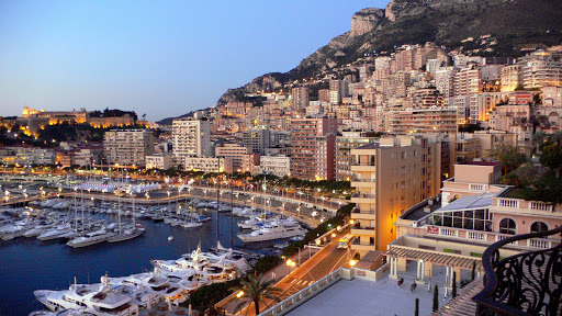 Monte-Carlo-skyline-harbor-at-dusk - View of the Monte Carlo skyline and marina from the Hermitage Hotel.
