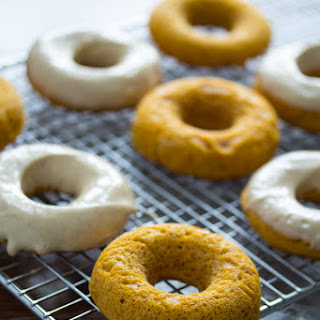 Pumpkin Donuts with Maple-Cinnamon Cream Cheese Frosting.