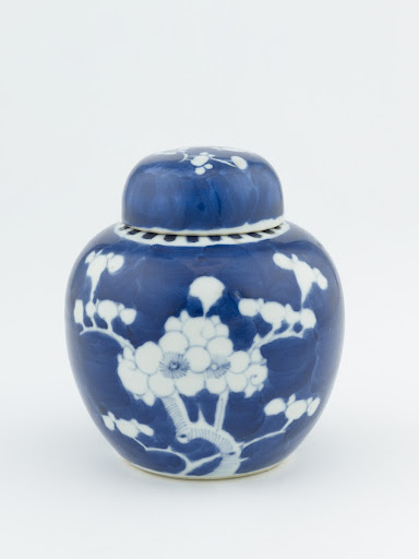 Ginger jar with domed cover, with design of blossoming prunus