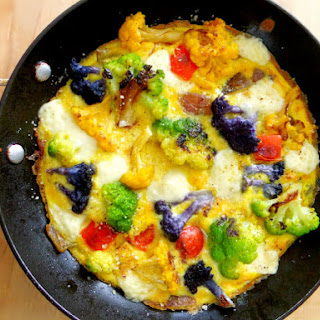 Colored Cauliflower Frittata with Red Pepper, Onions and Brie.
