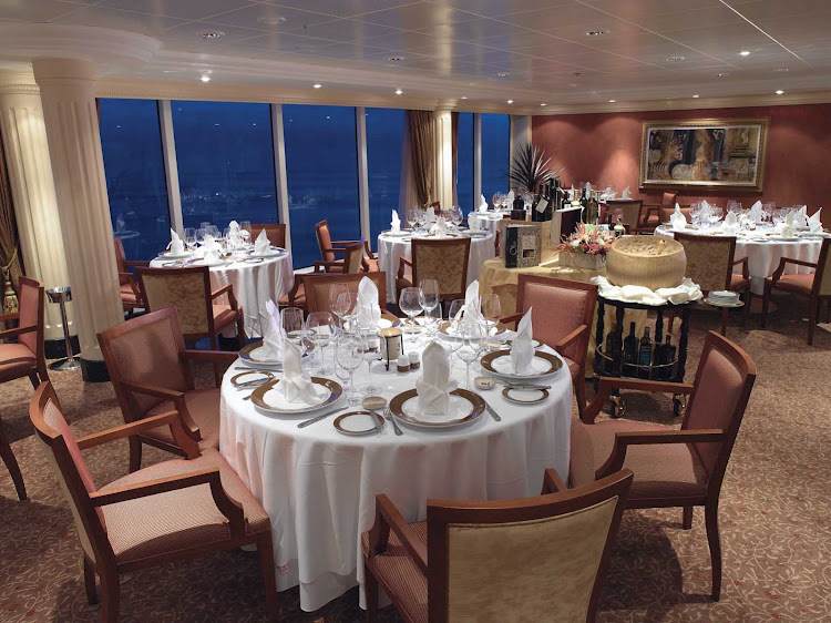 The expansive views and opulent dining room of Oceania Regatta's Toscana restaurant is a great setting to experience authentic Tuscan cuisine.
