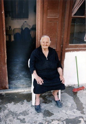townswoman-Skalini-Crete - We were charmed by this townswoman, who let us take her photo on the front porch of her stucco house in Skalani, a small village in Crete. We were invited into the house of a nearby neighbor who had never before seen an American.