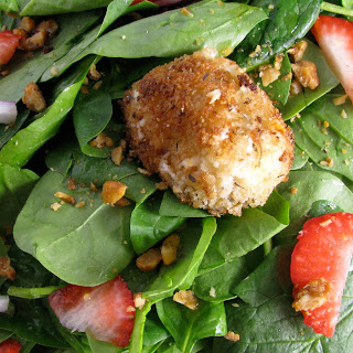 Warm Herb-Crusted Goat Cheese Spinach Salad.