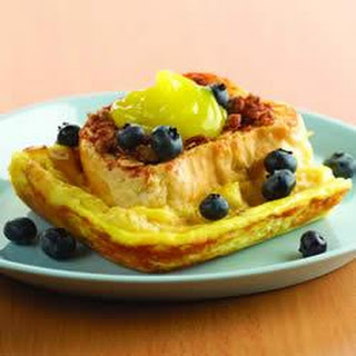 Lemon Cream Stuffed French Toast with Streusel Topper and Fresh Blueberries.