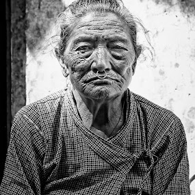 Haunting Woman by Nguyen Kien - Black & White Portraits & People ( black and white, hauting, nepali, old woman, serious )