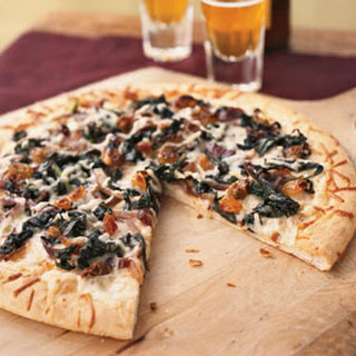 Winter Greens, Asiago, and Anchovy Pizza
