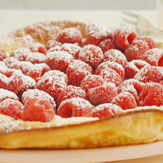 Oven-Puffed Pancake with Fresh Raspberries.