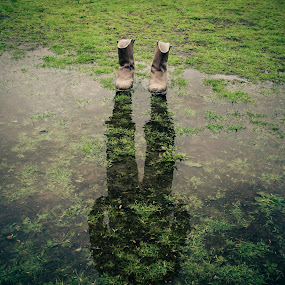 Reflection in puddle by Lee Davison - City,  Street & Park  City Parks ( missing, reflection, puddle, boots, photoshop )