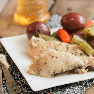 Slow Cooked Whole Chicken and Vegetables.