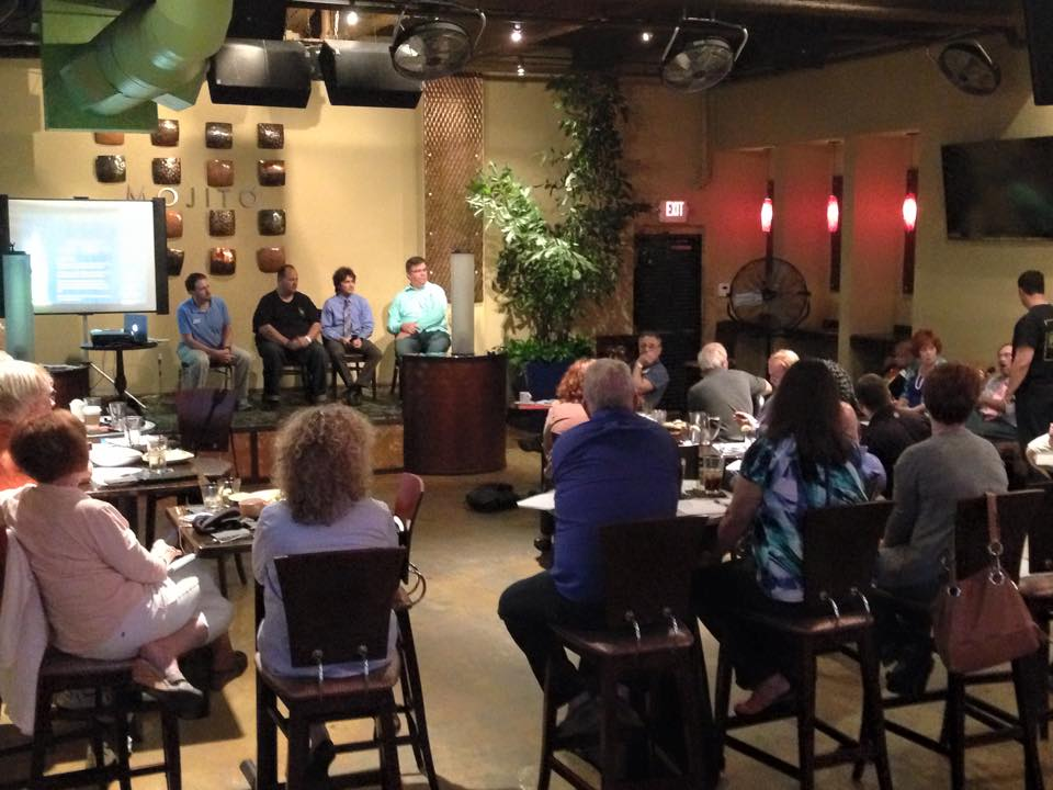 Photo of Stuart Mackey, Founder and Creative Director at Mackey Productions, answers questions regarding podcast production during a panel at the monthly Florida Podcaster's Association, in Tampa, FL.