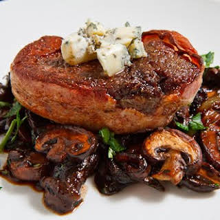 Double Smoked Bacon Wrapped Filet Mignon with Caramelized Mushrooms topped with Blue Cheese.