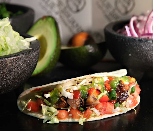 Carnival-Cruise-Lines-dining-BlueIguana-Cantina-taco - Head to the BlueIguana Cantina aboard your Carnival cruise for tacos and fresh Mexican cuisine in a casual atmosphere.