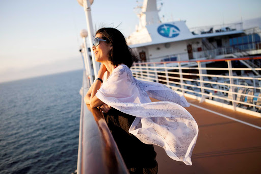 Azamara-Quest-on-deck - Enjoy the ocean breeze while taking in the horizon when you sail with Azamara.
