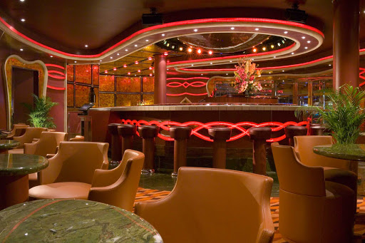 Carnival-Dream-Sams-Piano-Bar - Sing along to your favorite tunes or just chill with a cocktail and some friends at Sam's, a lively piano bar on Carnival Dream.