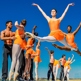 Flying high by Alexius van der Westhuizen - People Musicians & Entertainers ( flying, excellence, blue skies, active, ballet, leap, , blue, orange. color )
