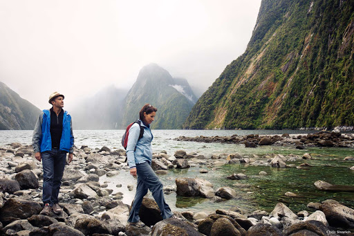 Rock_hopping_Milford_Sound - There's a prehistoric feel to Milford Sound. The steep cliffs, carved by an ancient glacier, are draped in native forest and ferns. High waterfalls plummet from river valleys, creating streaks of white amid the green.