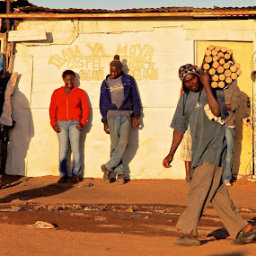by Jane Dunne - People Street & Candids ( walking, logs, street, africa, people,  )