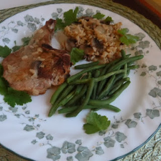 Baked Pork Chops with Brown Rice and Mushrooms.