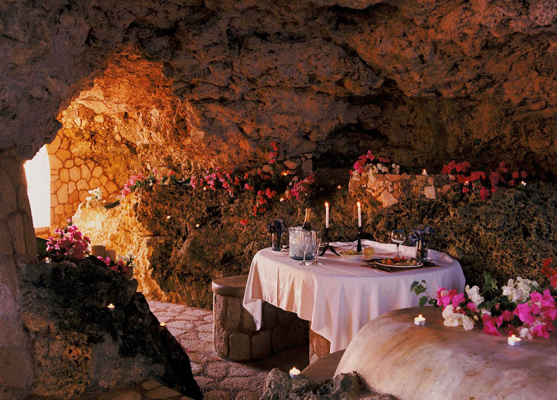 For a memorable dinner, dine at the Caves, an upscale oceanfront gazebo in Negril, Jamaica, with a hand-crafted stone table lit by candlelight.