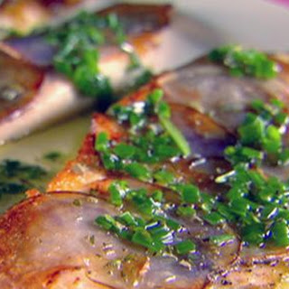 Tilapia With Purple Potato Crust And Chive Rosemary Oil.