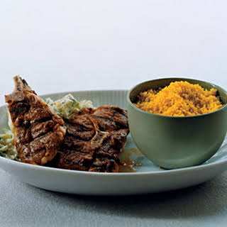 Grilled Lamb Chops with Curried Couscous and Zucchini Raita.