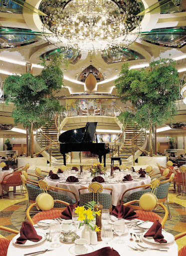 Legend-of-the-Seas-dining-room -  Romeo & Juliet is Legend of the Seas' two-story main dining room, adorned in marble with a graceful double staircase and central chandelier.