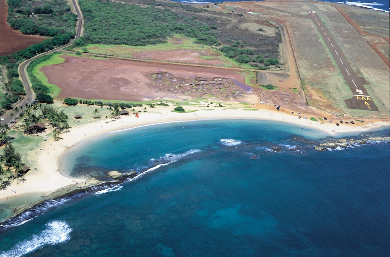 Aerial view of Salt Pond Beach Park in Hanapepe, Kauai, where Hawaiians since the 1600s have dried a red-dish sea salt in shallow red-clay pans.