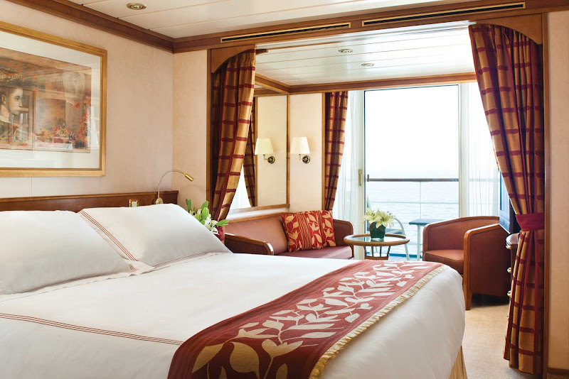 Wake up in your European king-size bed to an uninterrupted view when staying in Seven Seas Mariner's 301-square-foot Deluxe Veranda Suite.